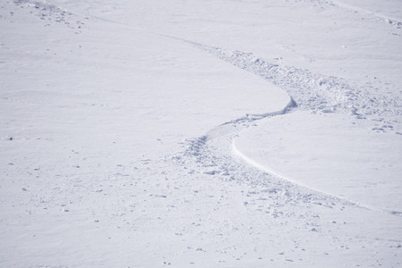 deep powder snow: Tracks on a mountain Slope, extreme freeride in deep snow