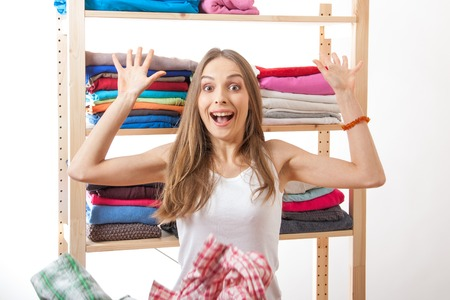 throws: woman throws a pile of clothes, isolated on white background