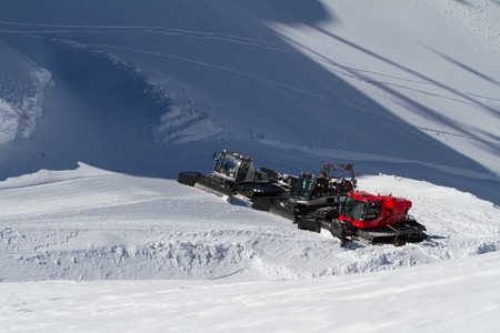 snow grooming machine: SOCHI, RUSSIA - MARCH 22, 2014: Ratraks, grooming machines, special snow vehicles in ski resort.