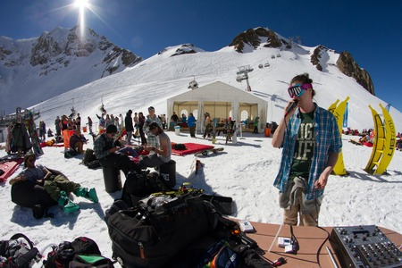 mc: SOCHI, RUSSIA - MARCH 22, 2014: Party in the ski resort, MC entertains tourists Editorial