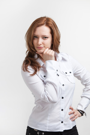 Portrait of young business woman thinking on white background photo