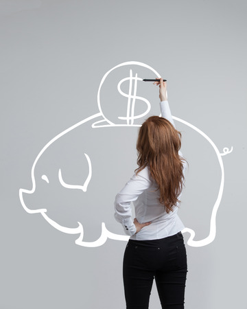 stylus: young businesswoman woman drawing a piggy Bank