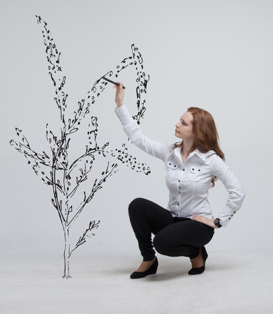 stylus: young woman drawing a plant
