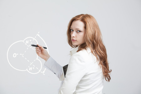 water molecule: Young woman draws water molecule Stock Photo