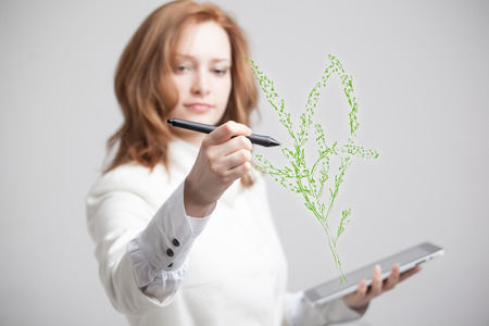 computer art: young woman drawing a plant