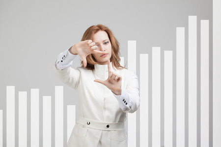 competencia: young businesswoman working with interactive graph