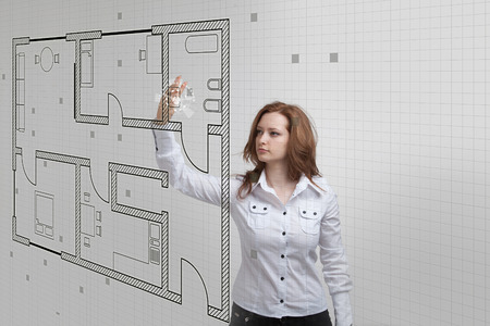 drawing a plan: Young woman architect working with a virtual apartment plan