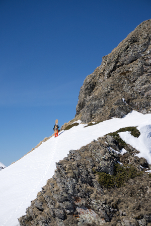 uphill: Snowboarder walking uphill for freeride, extreme sport Stock Photo