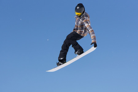 slopes: Snowboarder jumps in Snow Park, big air