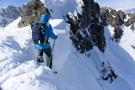 heli: Skier in deep powder, extreme winter freeride