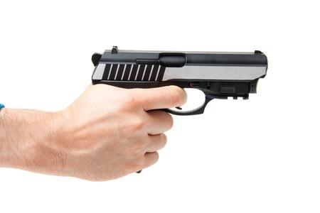 holding gun: Mans hand holding gun, isolated on white background. Stock Photo