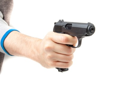 man holding gun: Mans hand holding gun, isolated on white background. Stock Photo
