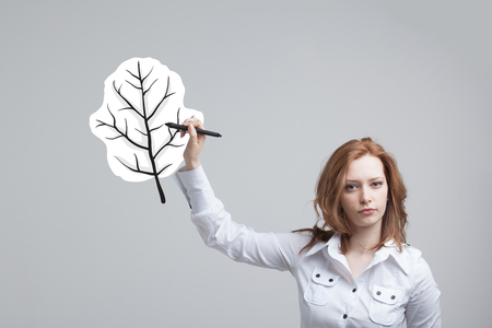 young leaf: young woman drawing a plant leaf