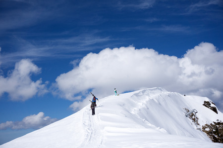 uphill: Skiers walking uphill for freeride, extreme sport
