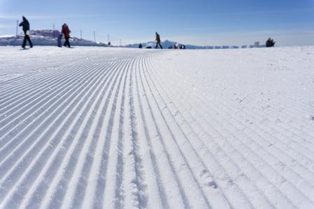 piste: Fresh snow groomer tracks on a mountain ski piste Stock Photo