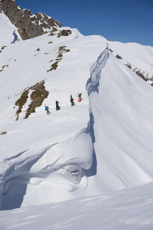 uphill: Snowboarders walking uphill for freeride, extreme sport