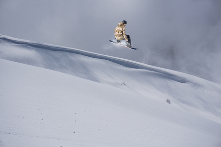 snowboarder: Snowboarder jumps in Snow Park, big air