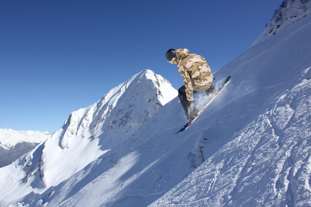 free image: Flying snowboarder on mountains, extreme sport Stock Photo