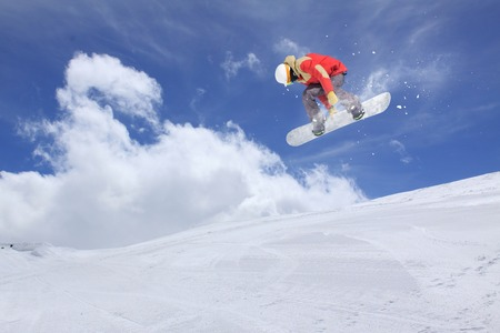 flight: Flying snowboarder on mountains, extreme sport Stock Photo