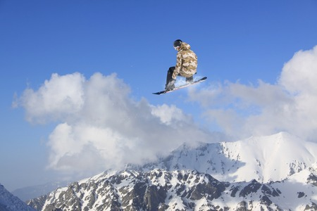 freeride: Flying snowboarder on mountains, extreme winter sport