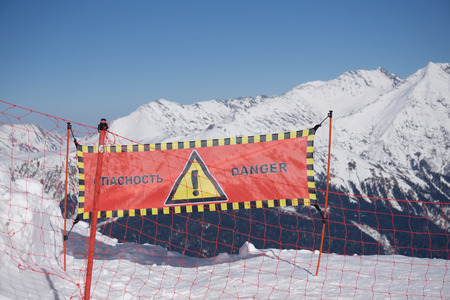 avalanche: Avalanche danger sign in snow, winter mountain ski resort Stock Photo