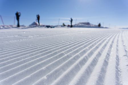 groomer: Fresh snow groomer tracks on a mountain ski piste Stock Photo