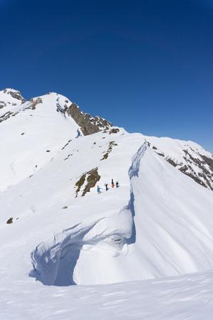 freeride: Snowboarders walking uphill for freeride, extreme sport