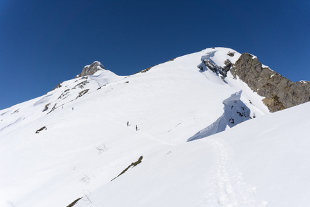 alpinist: Snowboarders walking uphill for freeride, extreme sport