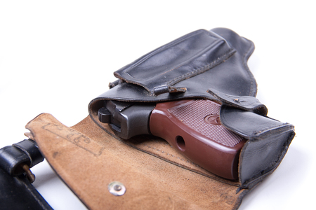 holster: Leather holster with gun, isolated on white background