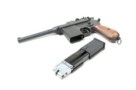 disassembled: Isolated disassembled gun on white background