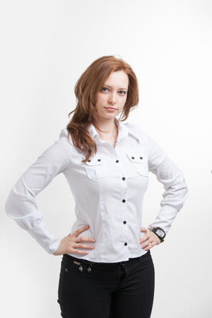 self assurance: Young businesswoman in white blouse, portrait