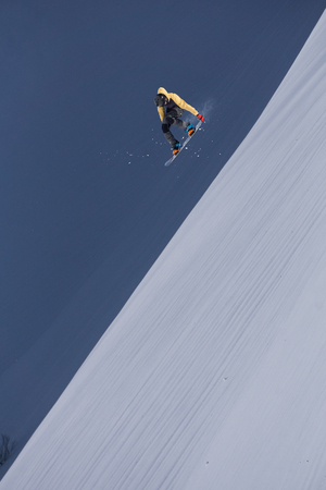 snowboarder jumping: Snowboarder jumping on mountains. Winter extreme sport.