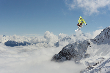 winter vacation: Flying skier on mountains. Extreme winter sport.