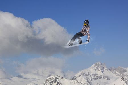 snowboarder jumping: Snowboarder jumping on mountains. Extreme winter sport.