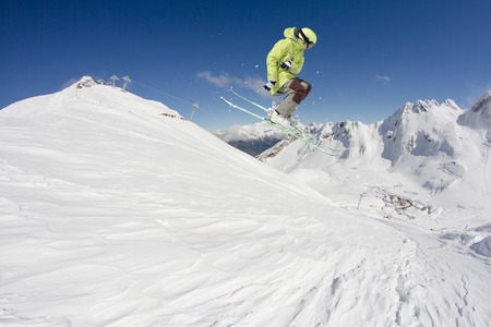 skier jumping: Skier jumping on mountains. Extreme winter sport.