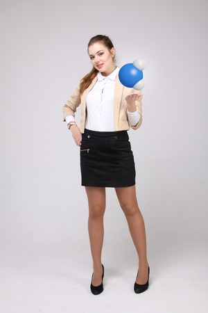 female scientist: Young woman scientist with model of water molecule, on gray background.