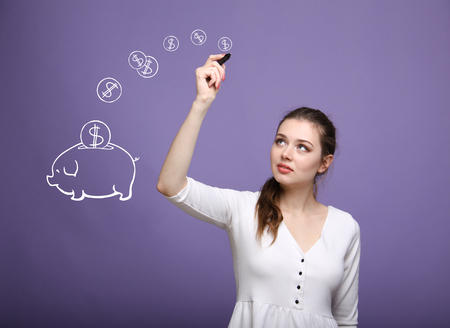drawing board: young businesswoman, woman drawing a piggy Bank Stock Photo