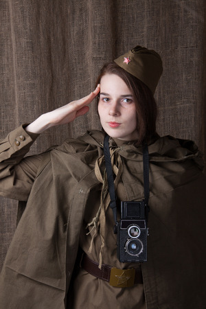 newsman: Young woman in Russian military uniform. Female war correspondent during the second world war. Stock Photo