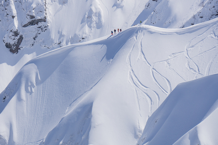 ski traces: Snowboard freeride, riders and tracks on a mountain slope. Extreme winter sport.