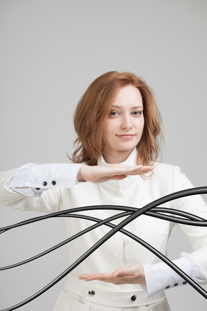 curved lines: Young woman with electrical cables or wires, curved lines