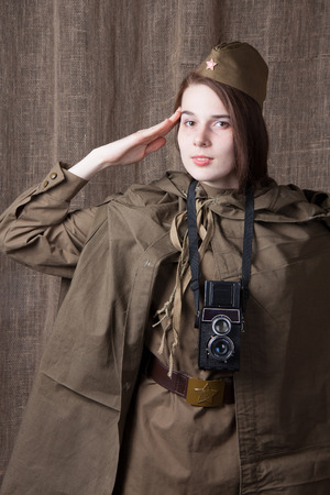 military press: Young woman in Russian military uniform. Female war correspondent during the second world war. Stock Photo