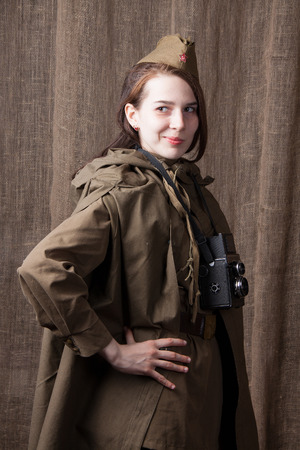correspondent: Young woman in Russian military uniform. Female war correspondent during the second world war. Stock Photo