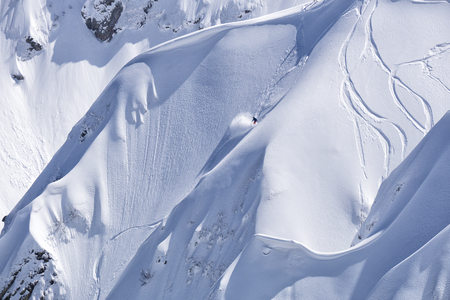 freeride: Snowboard freeride, riders and tracks on a mountain slope. Extreme winter sport.