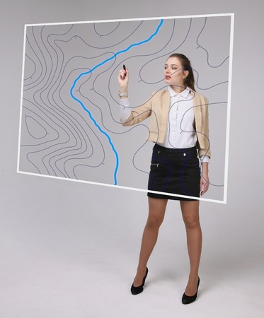topographical: Geographic information systems concept, woman scientist working with futuristic interface in GIS software on a transparent screen.