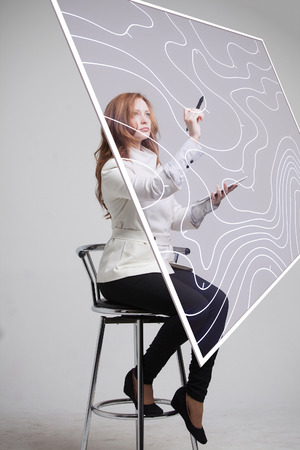 geodesy: Geographic information systems concept, woman scientist working with futuristic interface in GIS software on a transparent screen.