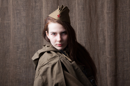 Young woman in Russian military uniform. Female soldier during the second world war. Stock Photo