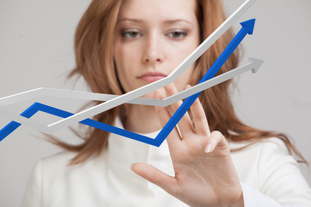 executive women: Young businesswoman working with growth graph. Financial business concept on grey background