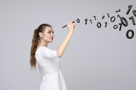 Young woman working with binary code, concept of digital technology.