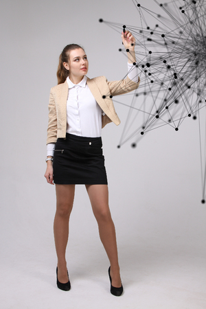 linked hands: Worldwide network or wireless internet connection futuristic concept. Young woman working with linked dots on grey background. Stock Photo