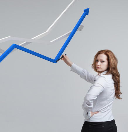 stylus pen: Young businesswoman working with growth graph. Financial business concept on grey background